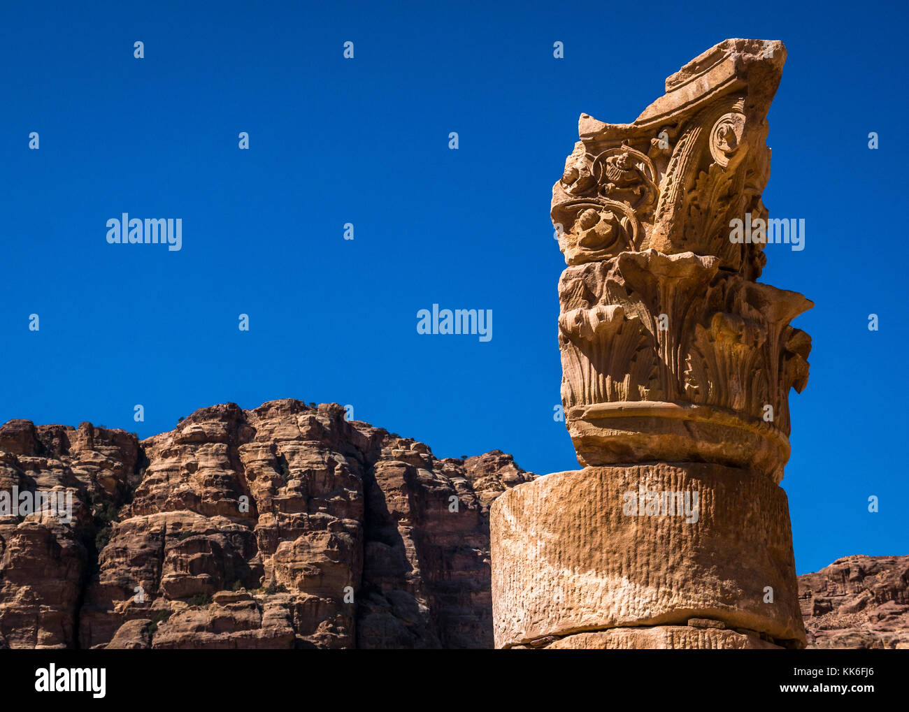 Close up of carved acanthus leaf detail of a ruined Corinthian column at the Great Temple, Petra, Jordan, Middle - Stock Image