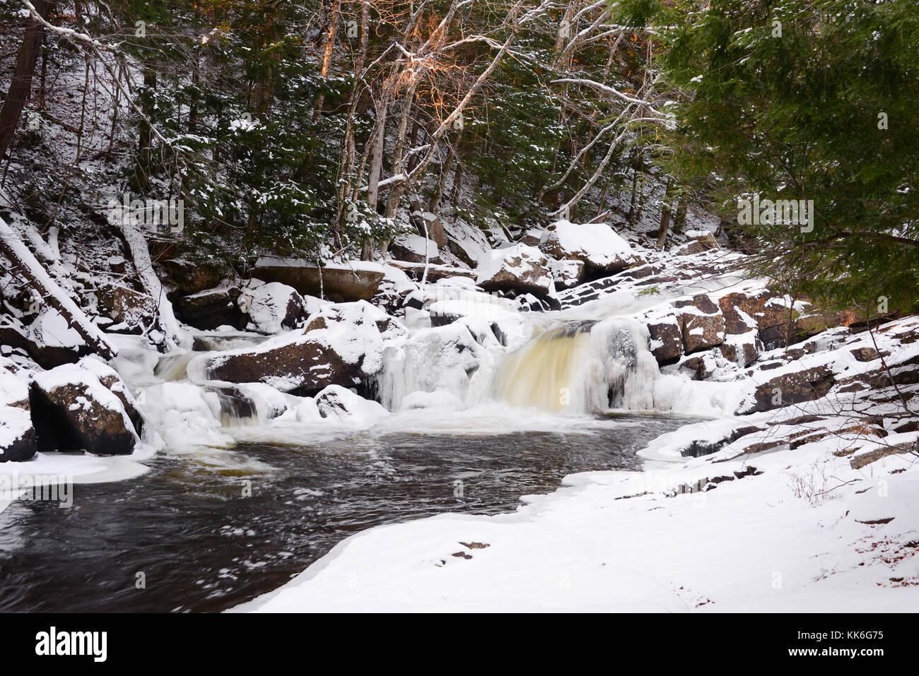 Austin Falls - winter waterfalls with snow and ice on the Sacandaga River in the Adirondack Mountains, NY, USA - Stock Image