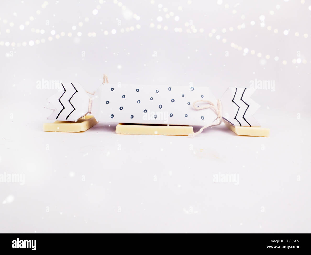 Christmas Decoration with black and white cracker chocolate box with golden bokeh and snow for holidays best background Stock Photo