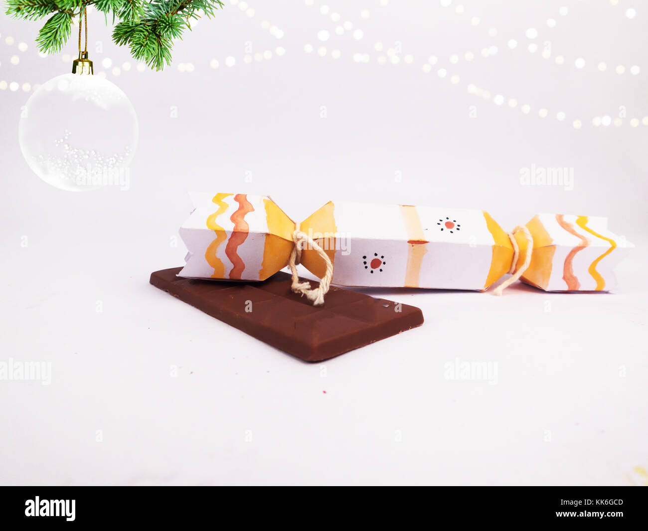 Christmas Decoration with cracker chocolate box and dark chocolate bar with christmas ball for holidays best background Stock Photo