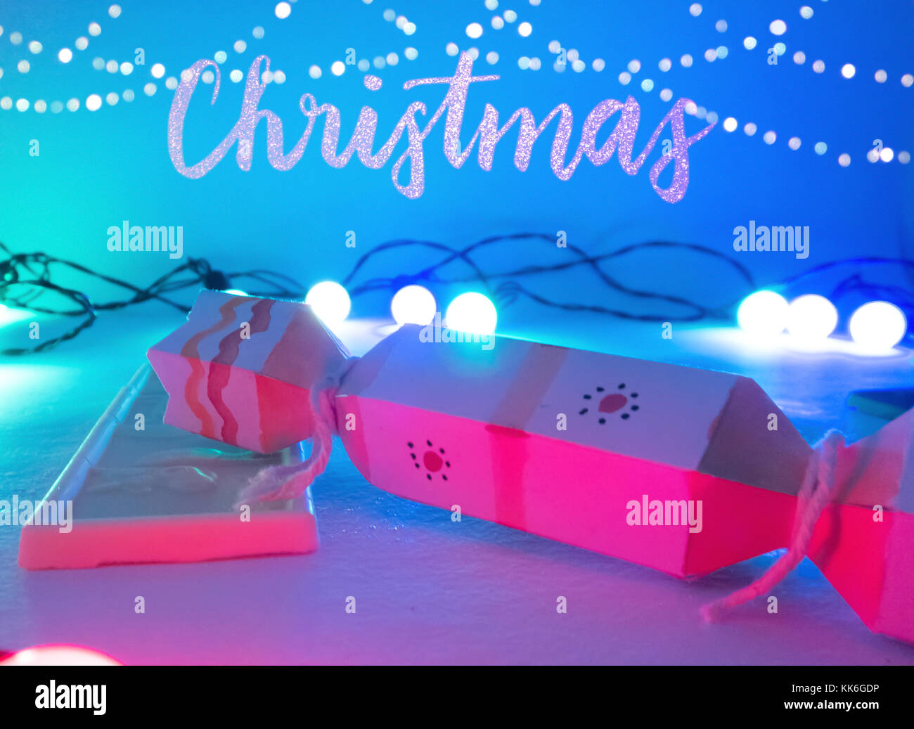 Christmas Decoration with cracker chocolate box and white chocolate bar with golden bokeh  for holidays best background Stock Photo