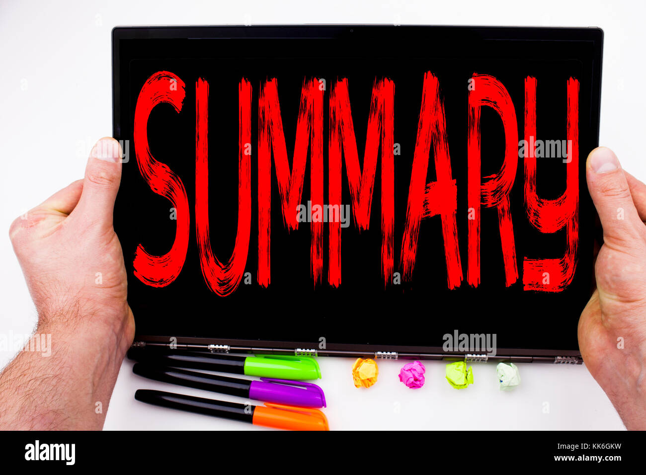 Summary text written on tablet, computer in the office with marker, pen, stationery. Business concept for Brief - Stock Image