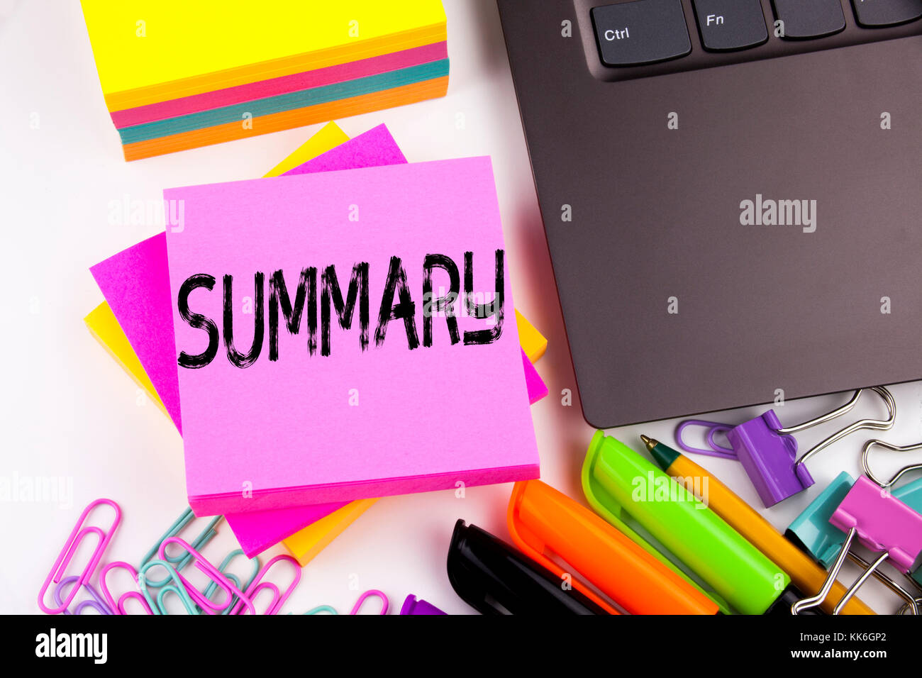 Writing text showing Summary made in the office with surroundings such as laptop, marker, pen. Business concept - Stock Image