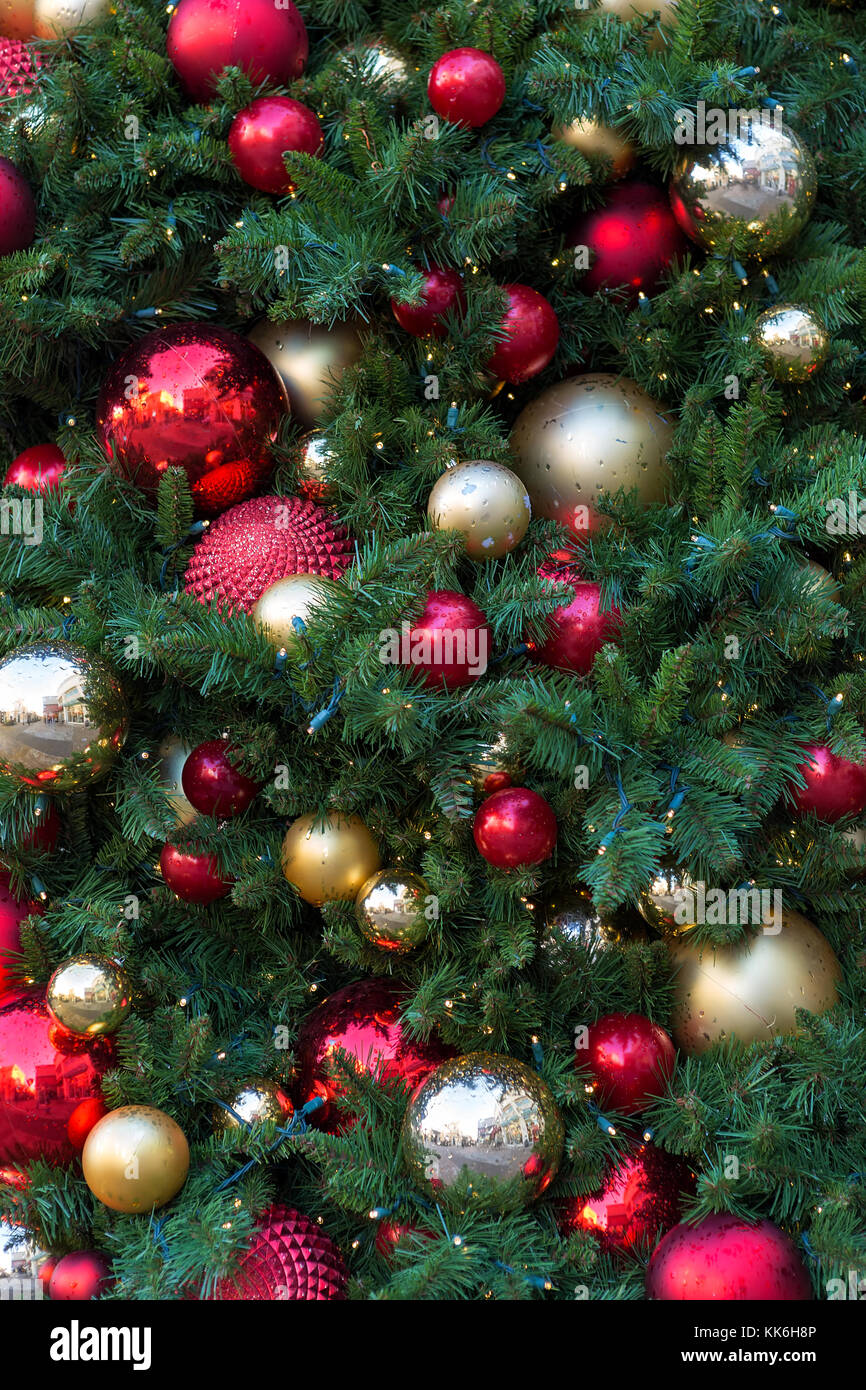 Christmas Holiday Tree With Round Ball Ornaments In Gold Red Silver Stock Photo Alamy