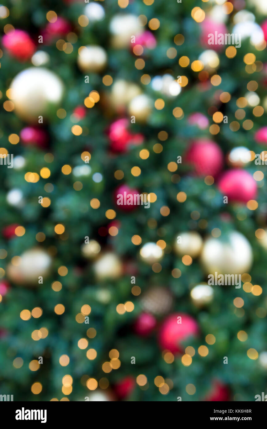 Christmas Holiday Tree With Round Ball Ornaments In Gold Red Silver Lighting Blurred Defocused Bokeh Background