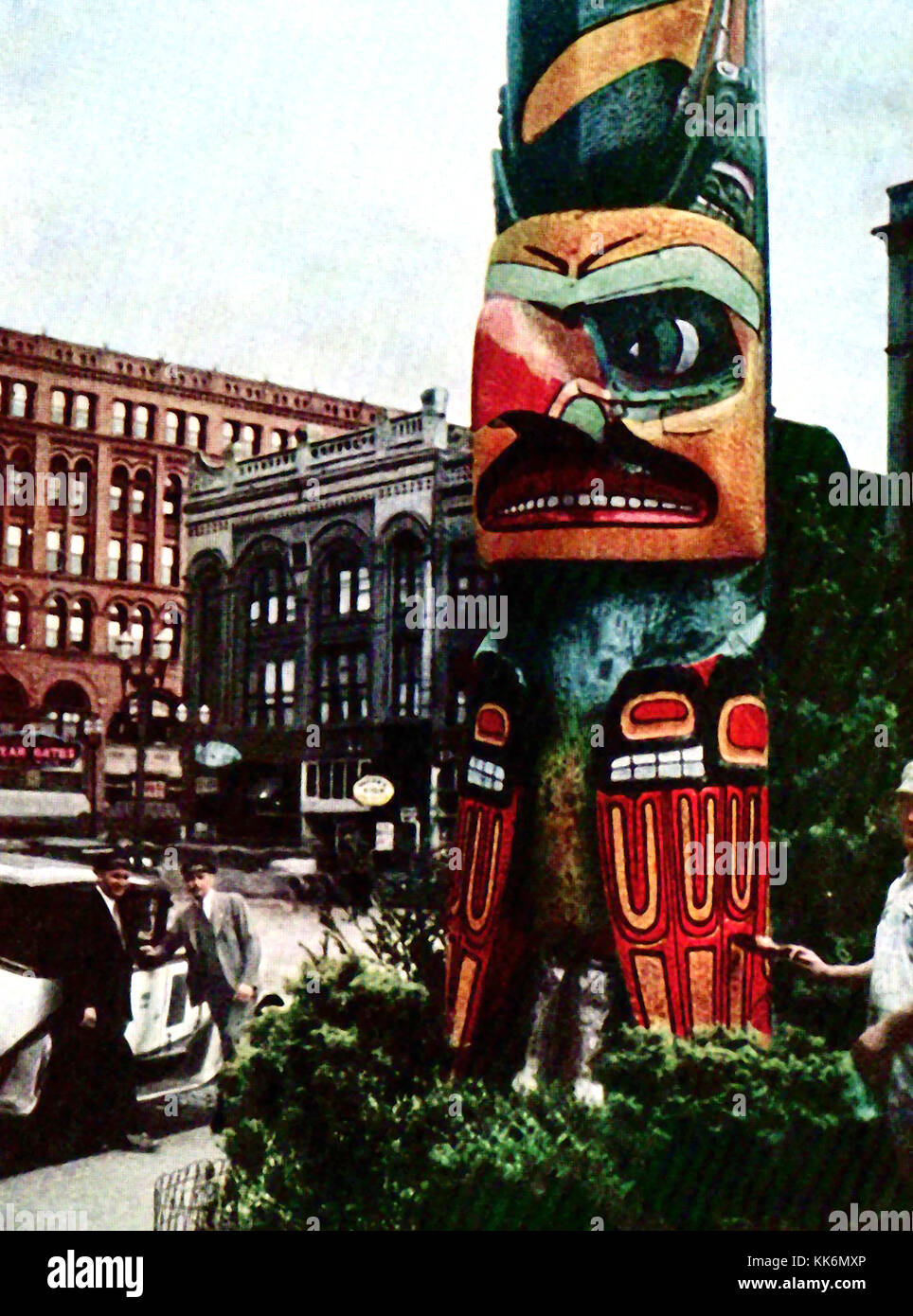 1933 - Vintage color photograph of the Native Indian Totem Pole in Pioneer Square, Downtown Seattle.  Originally - Stock Image