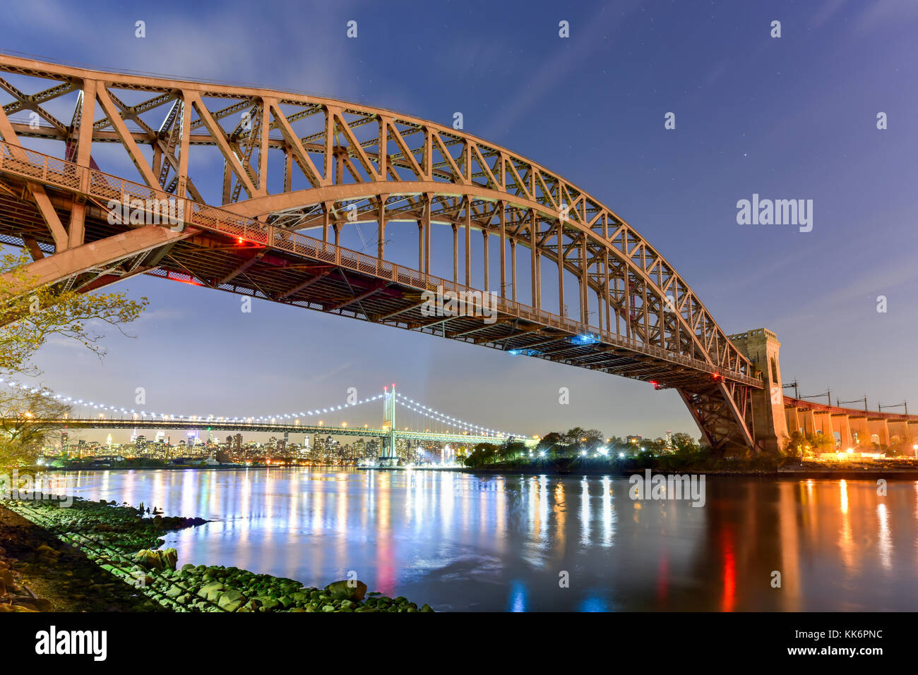 Hell Gate Bridge and Triboro Bridge at night, in Astoria, Queens, New York. - Stock Image
