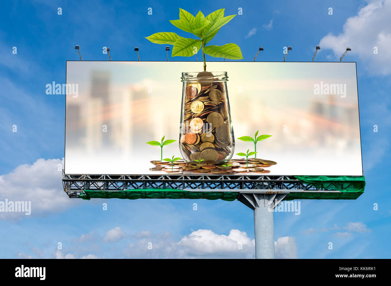 Billboard on beautiful sky showing the Gold coin and seed in clear bottle on cityscape photo blurred cityscape background,Business - Stock Image