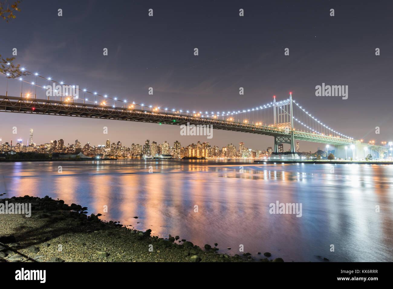 Robert F. Kennedy Bridge (aka Triboro Bridge) at night, in Astoria, Queens, New York - Stock Image