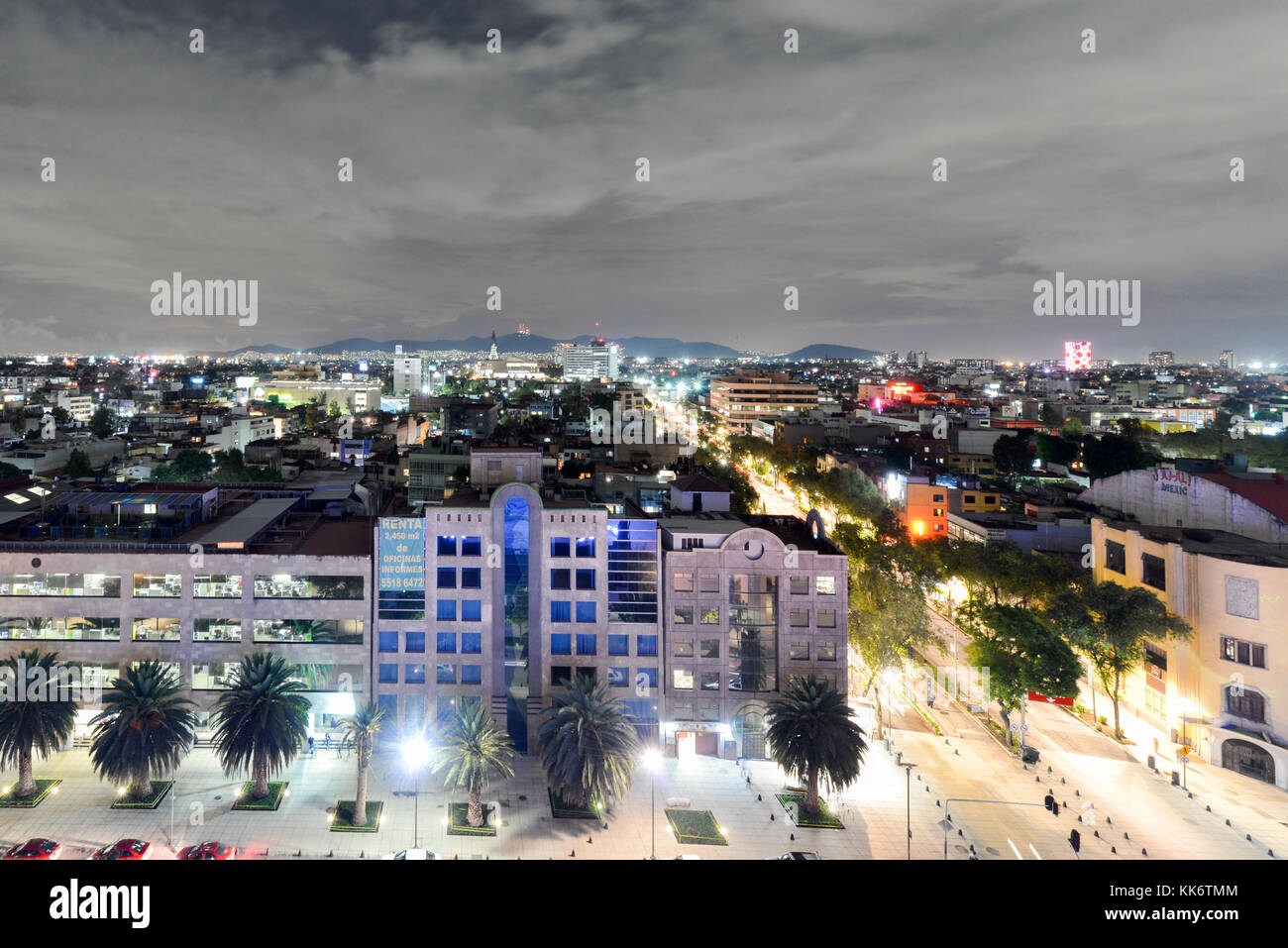 Mexico City Skyline at night from the Monument to the Mexican Revolution. - Stock Image