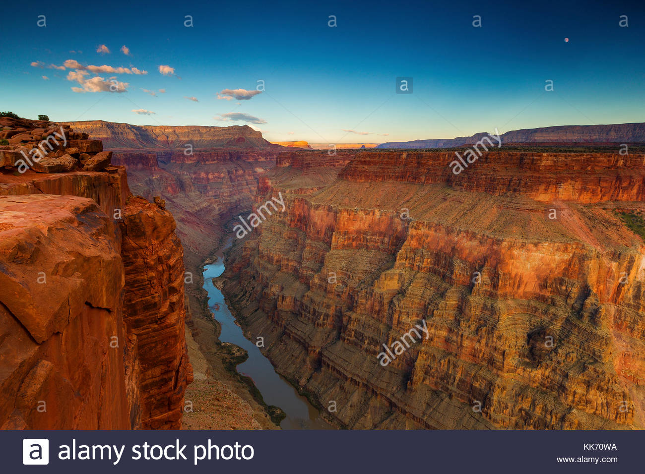 The full moon rises over the Grand Canyon and Colorado River in this view from the Tuweep Overlook (also spelled - Stock Image
