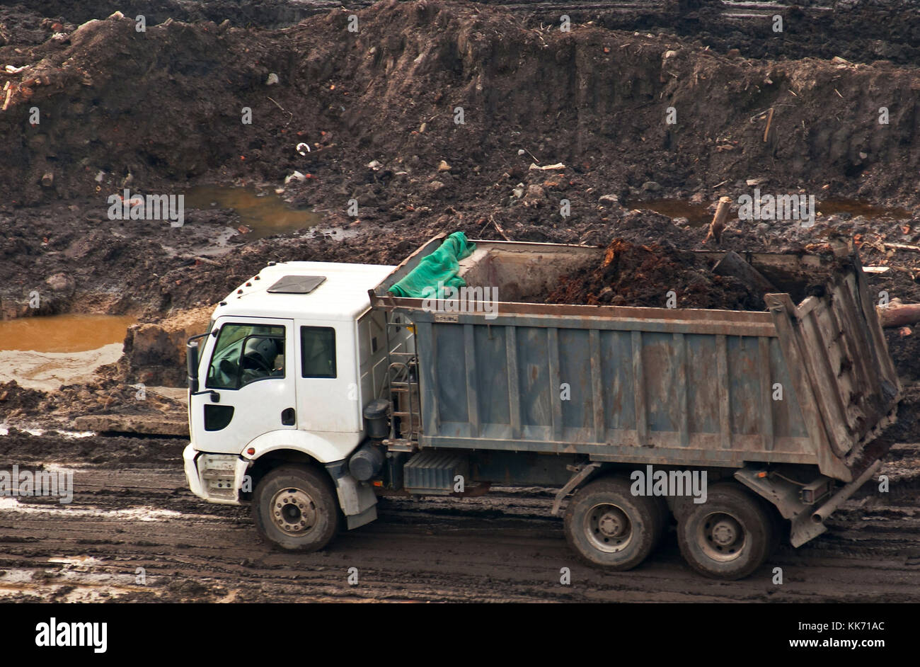 Dump truck in the basin on the construction of a new house. - Stock Image