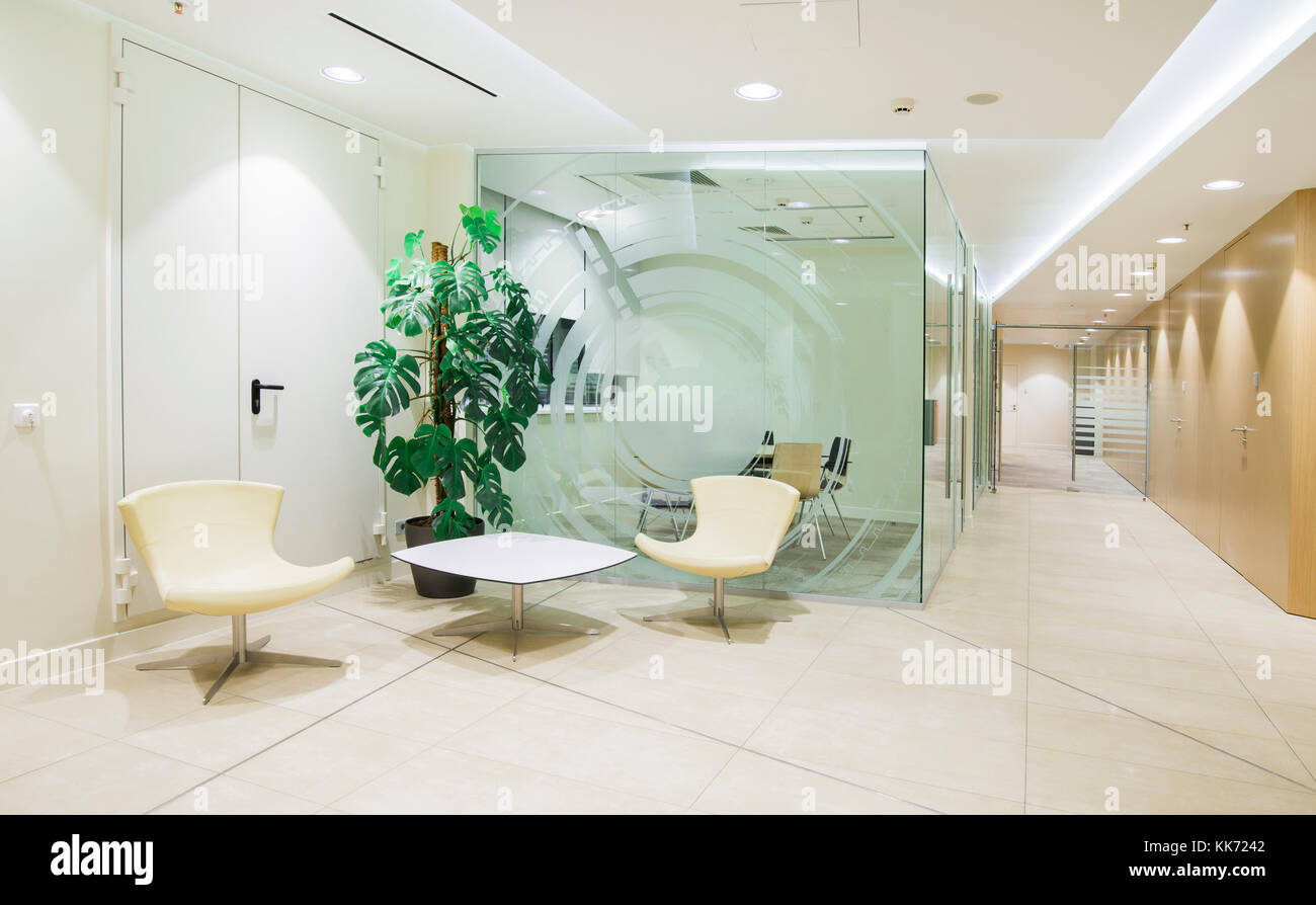 bright office. Interior Of Modern Bright Office With Glass Walls - Stock Image