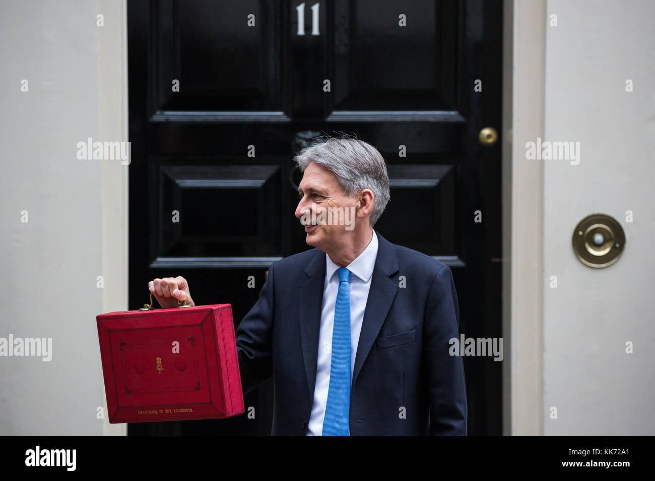 London, UK. 22nd November, 2017. Philip Hammond MP, Chancellor of the Exchequer, holds up the red case as he leaves - Stock Image