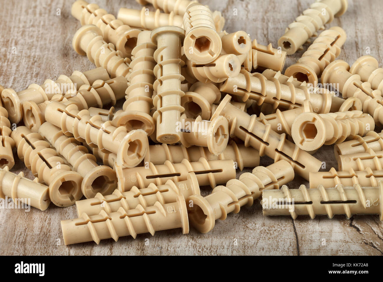 Plastic dowel for mounting on a wooden table. Close-up. Studio lighting. - Stock Image