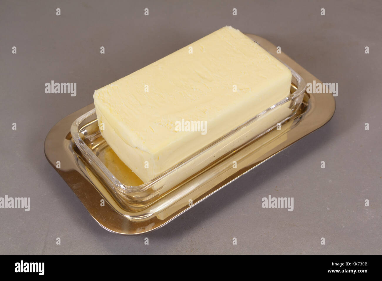 Pack of butter in a butter dish made of metal and glass Stock Photo