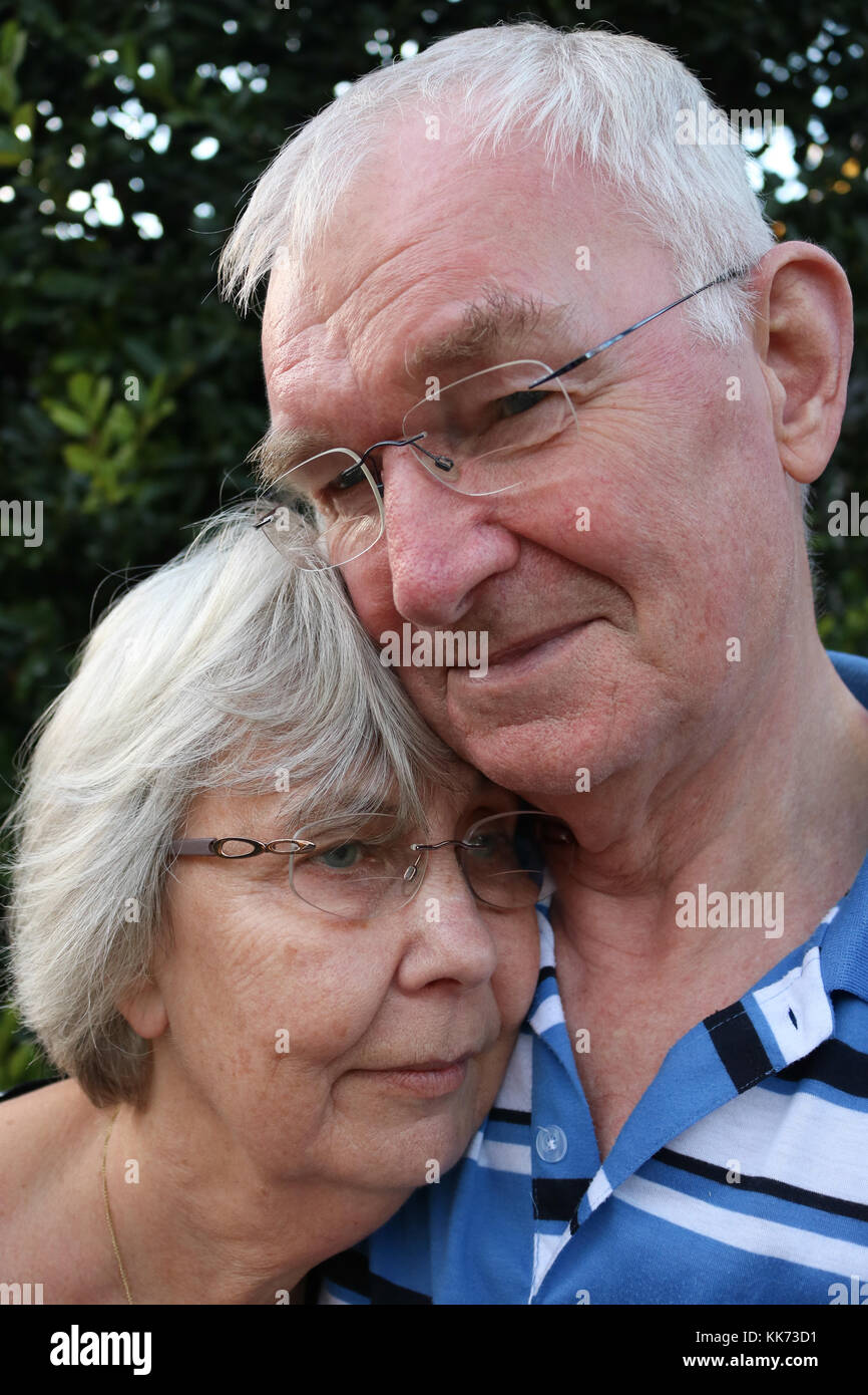 Portrait of a senior couple in a loving embrace - Stock Image