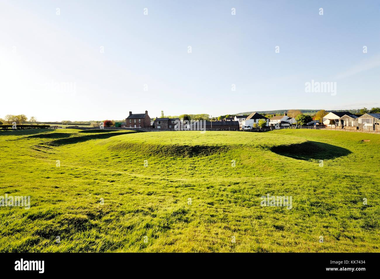 The prehistoric Neolithic henge earthworks known as King Arthurs Round Table at Eamont Bridge, near Penrith, Cumbria, - Stock Image