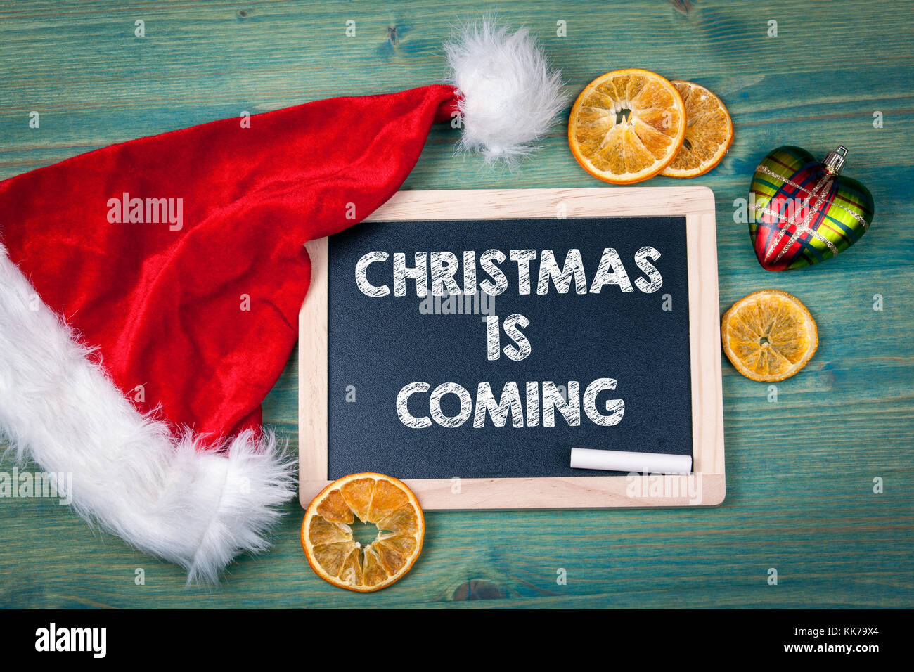 Christmas is Coming. Holiday background. Ornaments and decor on a wooden table - Stock Image