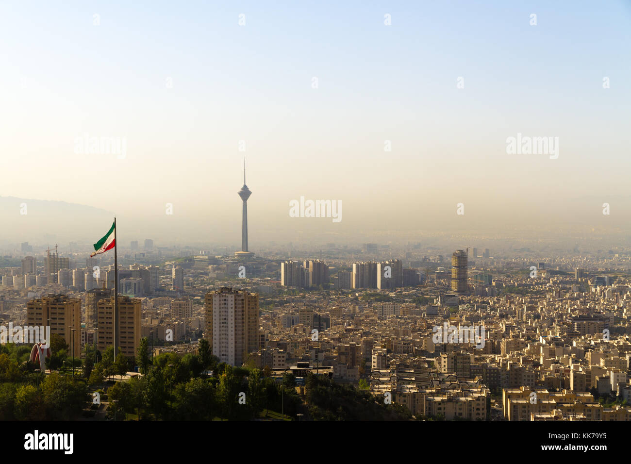 Tehran city skyline with Iranian flag and Milad Tower (Borj-e Milad landmark, hight 435 m.). - Stock Image