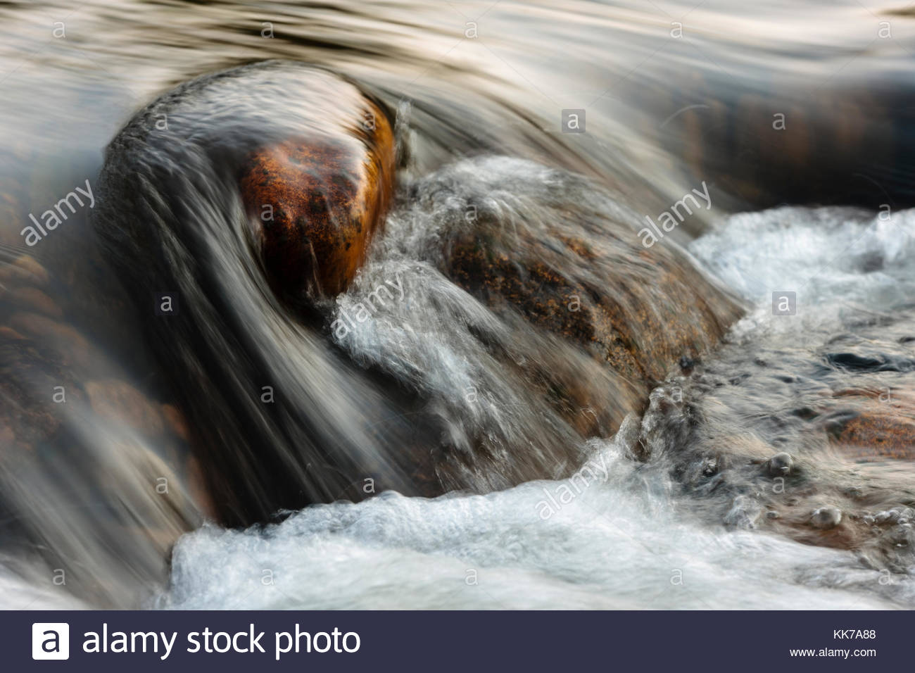 The clear water of the Big Thompson flows swiftly over the boulders in Estes Park, Colorado - Stock Image