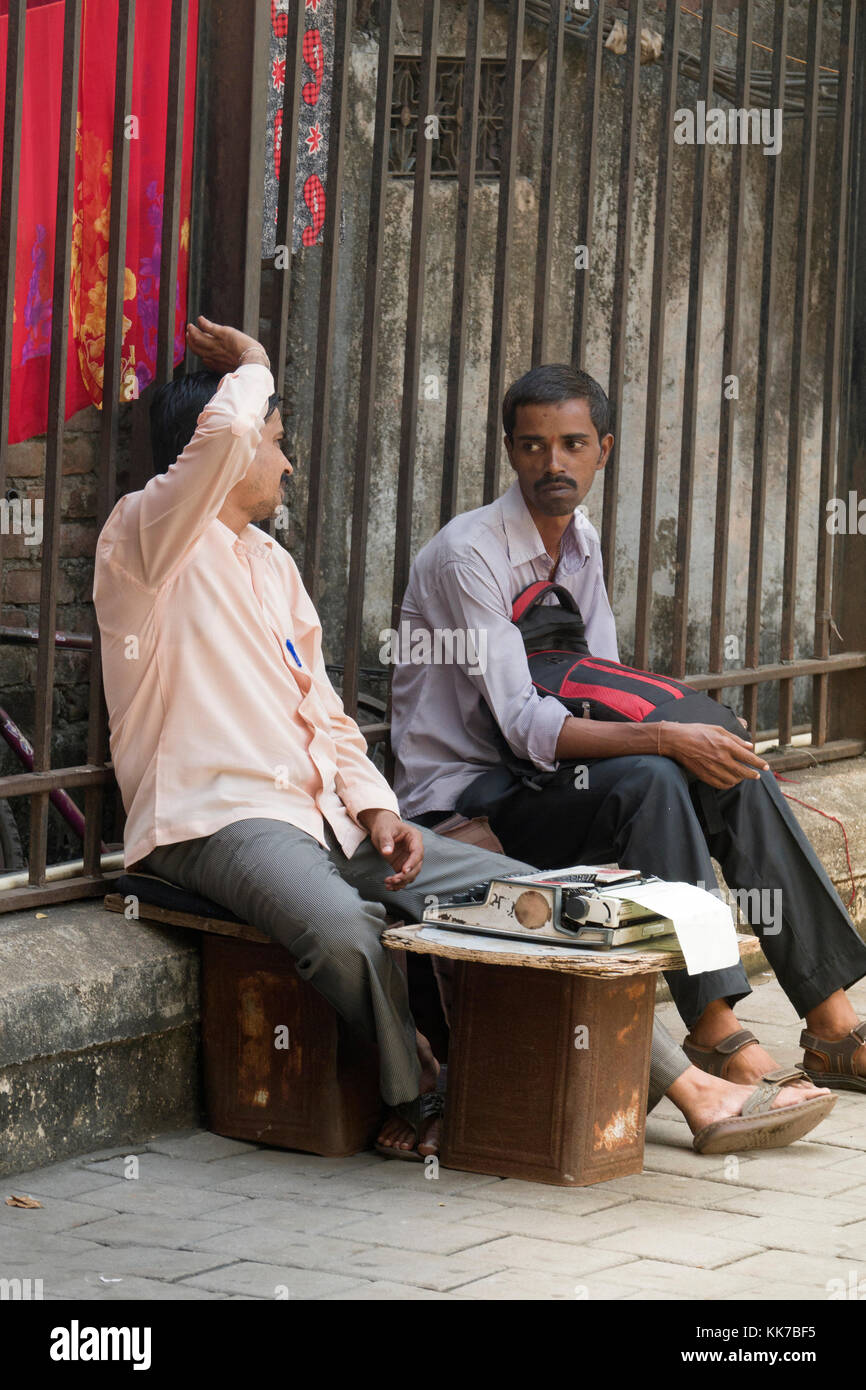 Legal document typist in street outside Bombay High Court in Mumbai, India - Stock Image