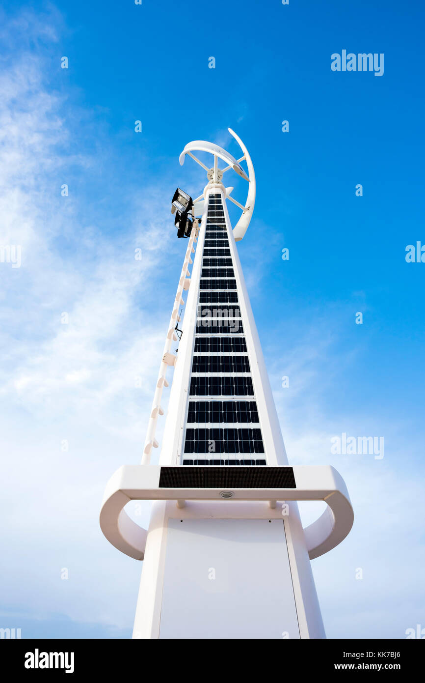 Solar and wind turbine hybrid systems installed at Dubai open beach Jumeirah, United Arab Emirates - Stock Image