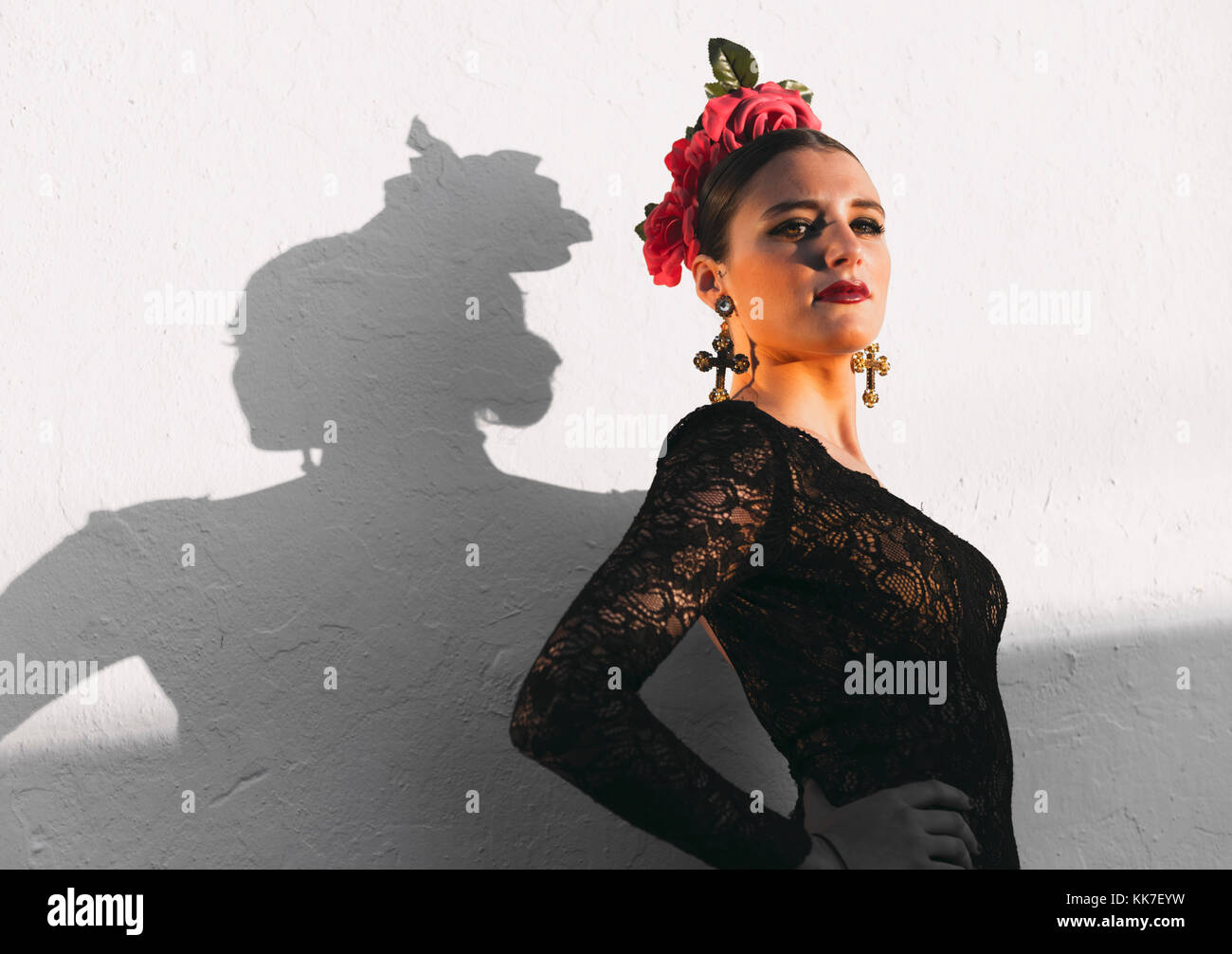 Spanish woman in a typical flamenco dress. - Stock Image