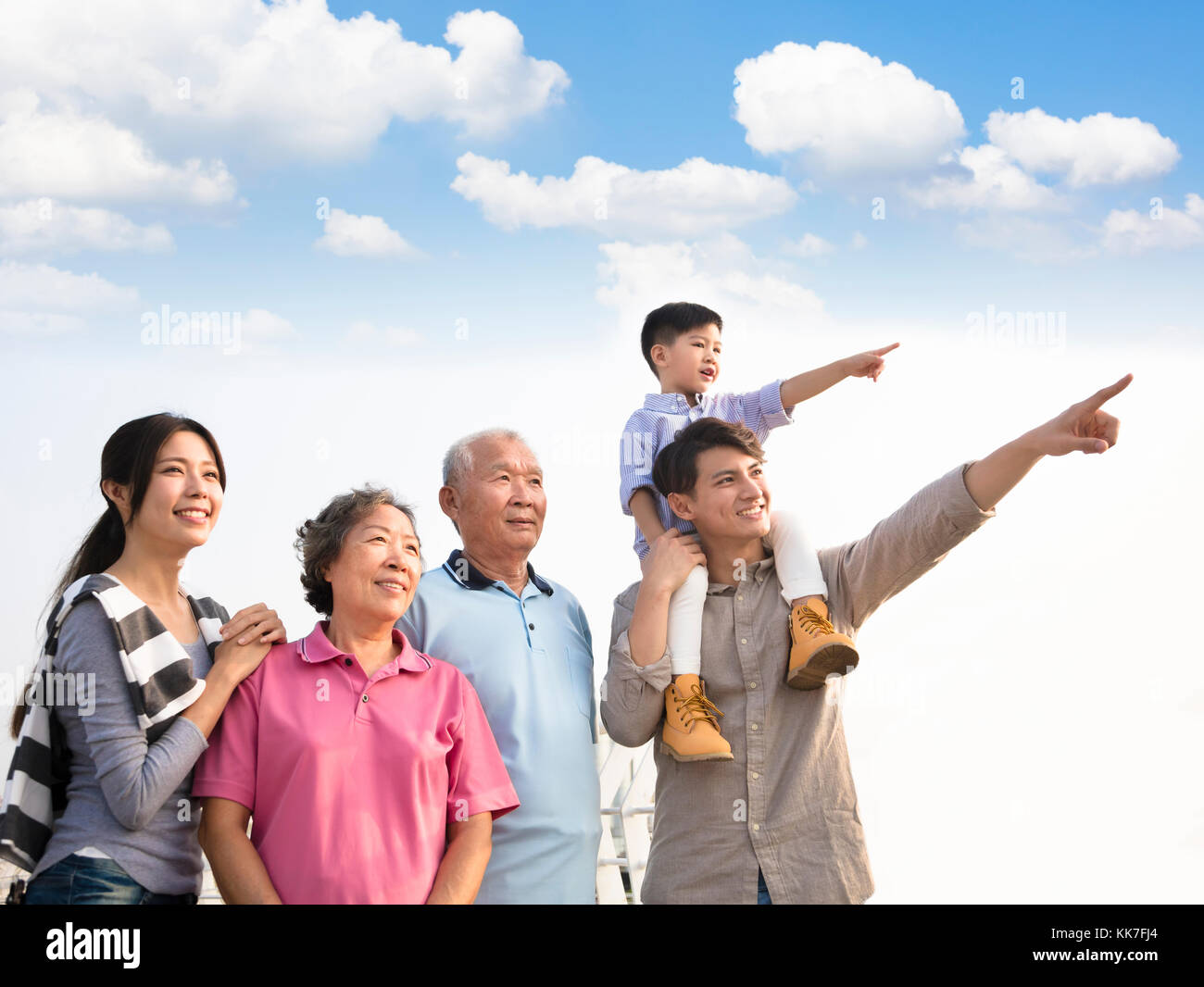 three generations family having fun together outdoors - Stock Image