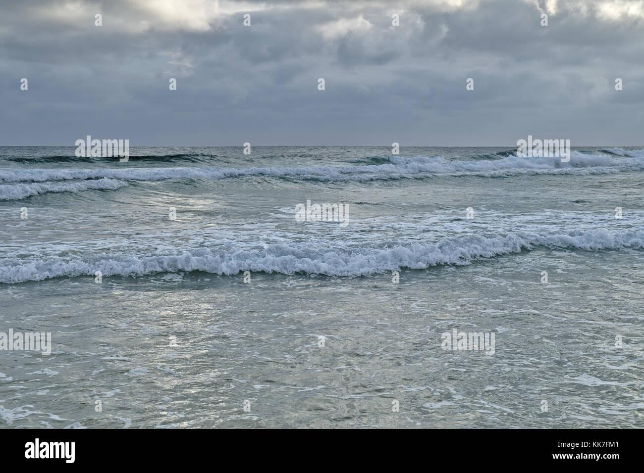 Cloudy scene in Ilha Deserta (Desert Island). Faro, Algarve, Portugal - Stock Image