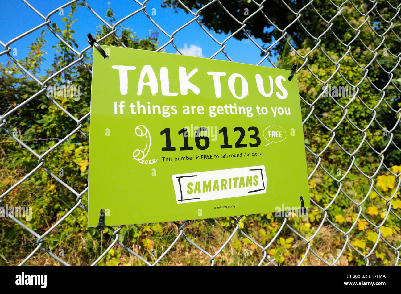 Samaritans sign with telephone helpline number Stock Photo