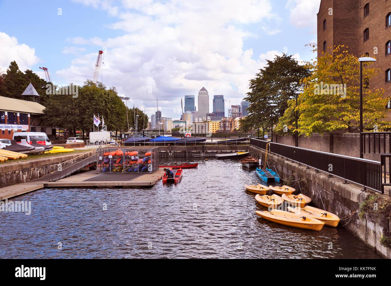 Shadwell Basin Outdoor Activity Centre and Canary Wharf skyline, Tower Hamlets, London, UK, - Stock Image