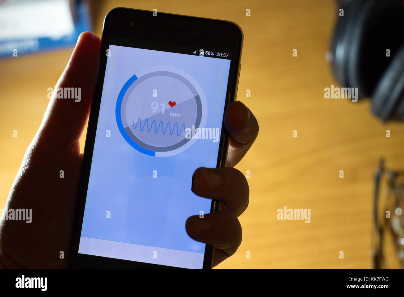 smartphone app heart rate monitor that works with camera sensor - Stock Image