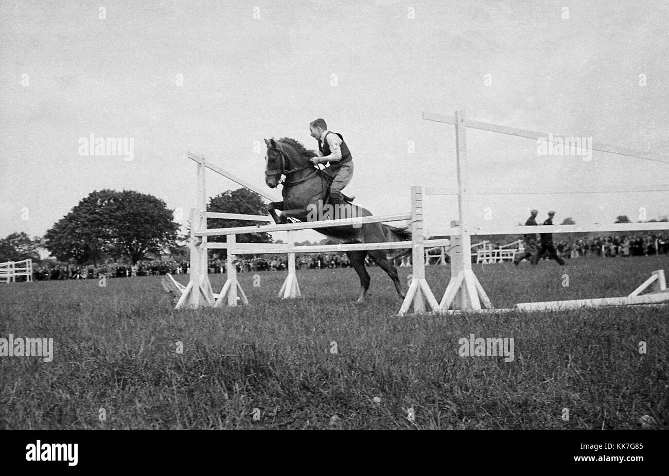 1940s, historical picture, eventing competition, a boy riding a horse without any protective headgear attempting - Stock Image