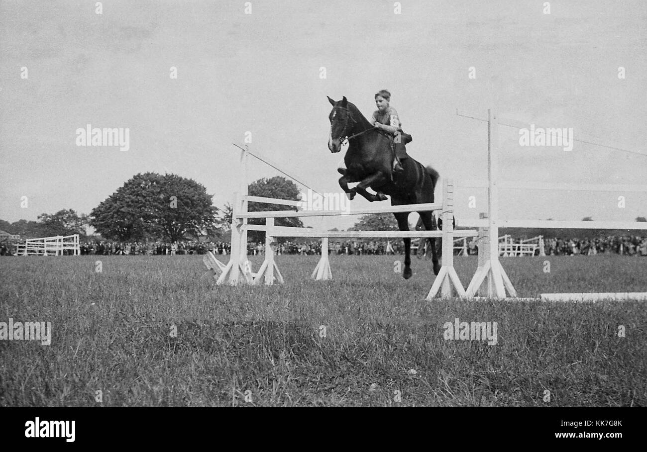 1940s, historical picture, eventing competition, a young lad on a horse jumping a fence, showing good technique - Stock Image