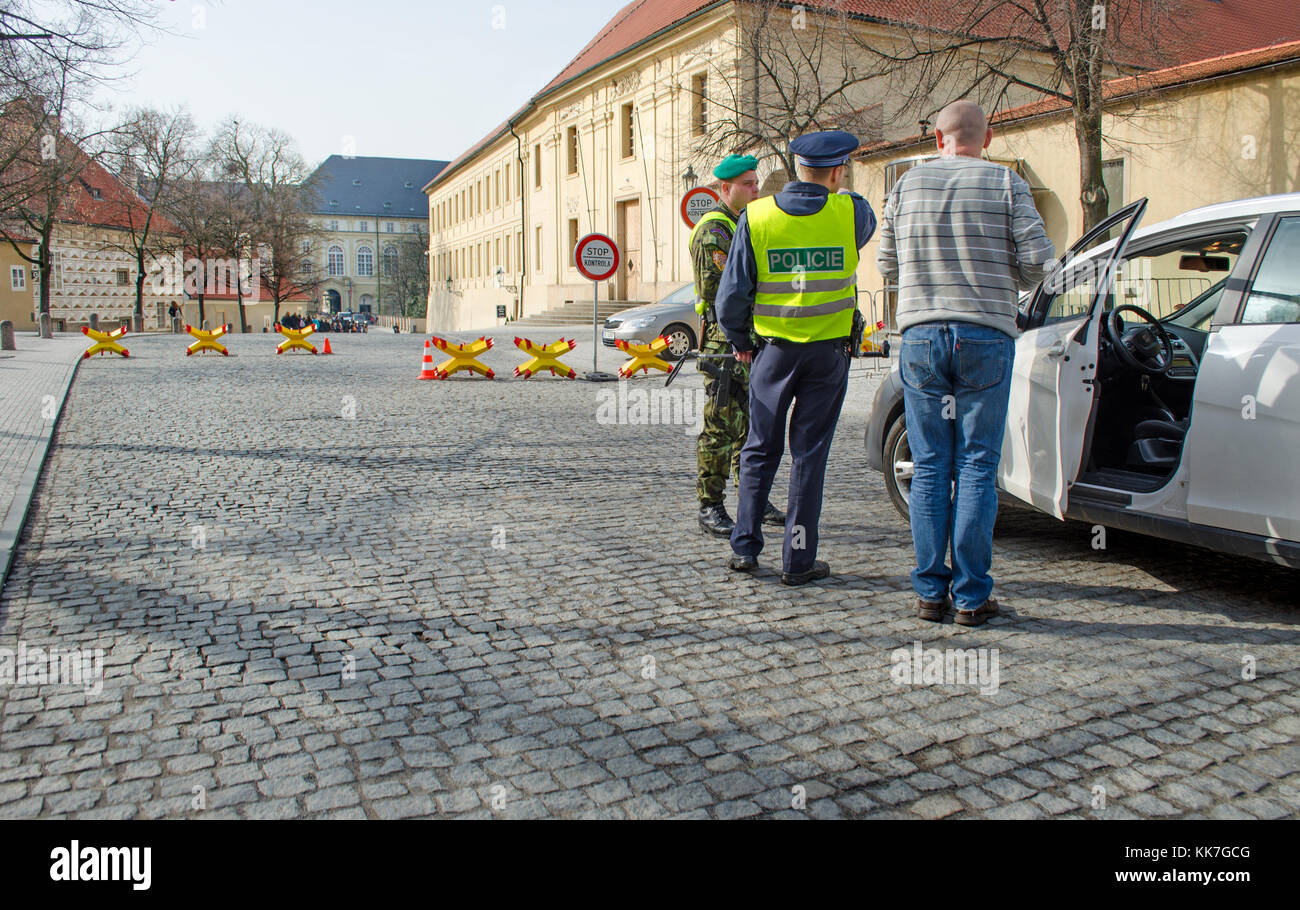 Prague, Czech Republic. Police, soldiers and a security barrier stopping vehicles approaching the castle during - Stock Image