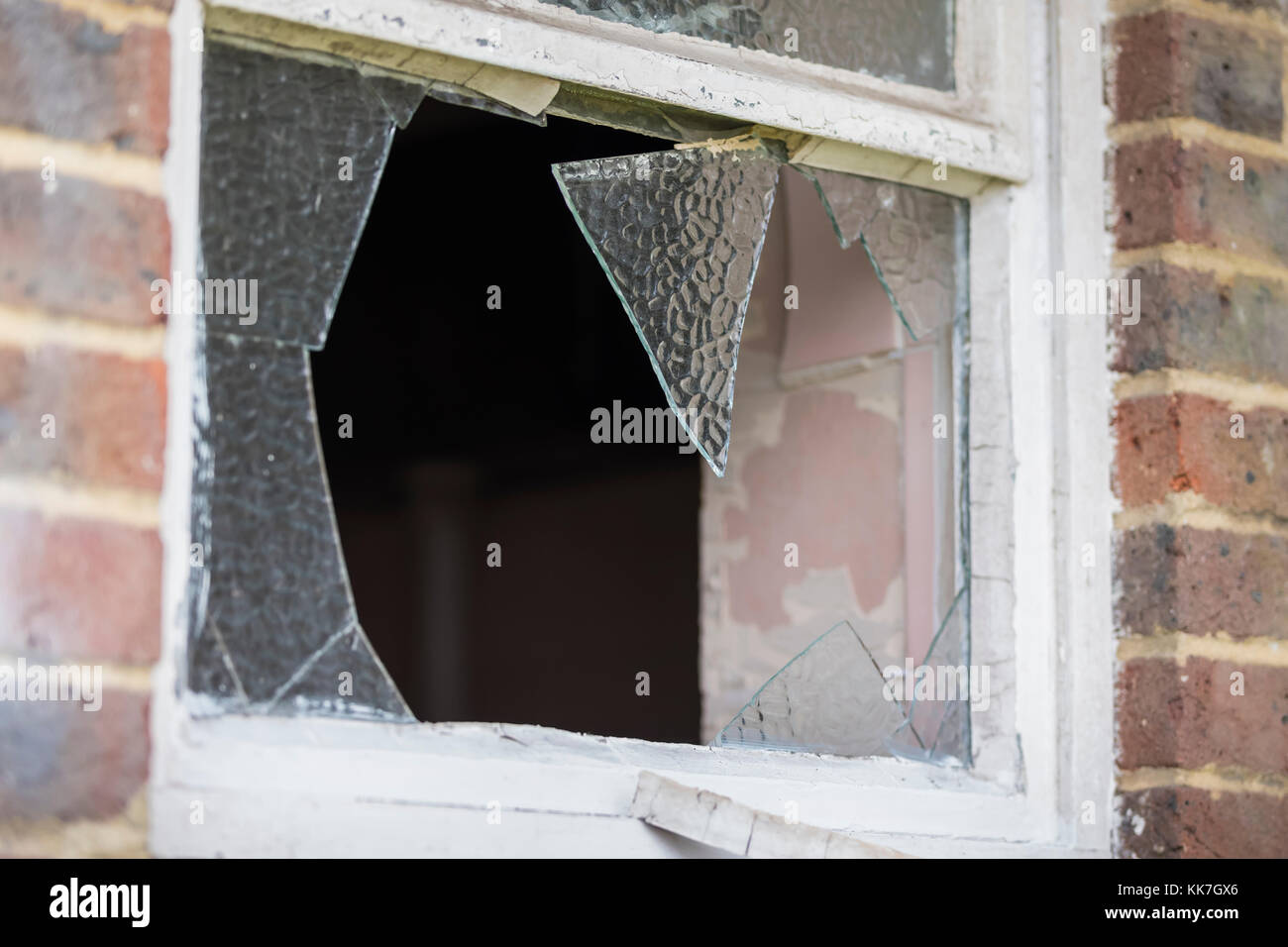Broken window in a disused building. - Stock Image
