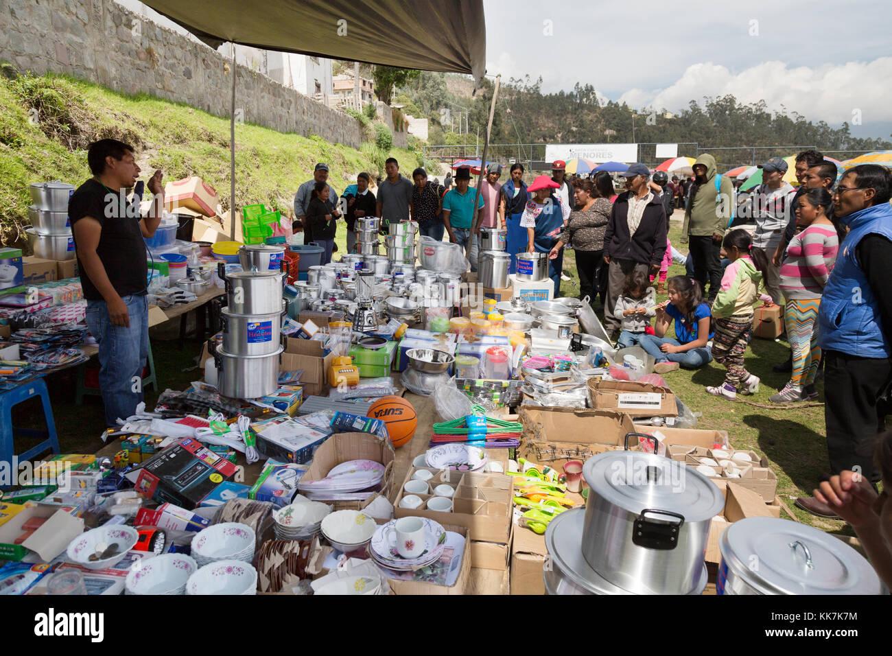 People shopping at Otavalo Market stall, Otavalo, Ecuador, South America - Stock Image