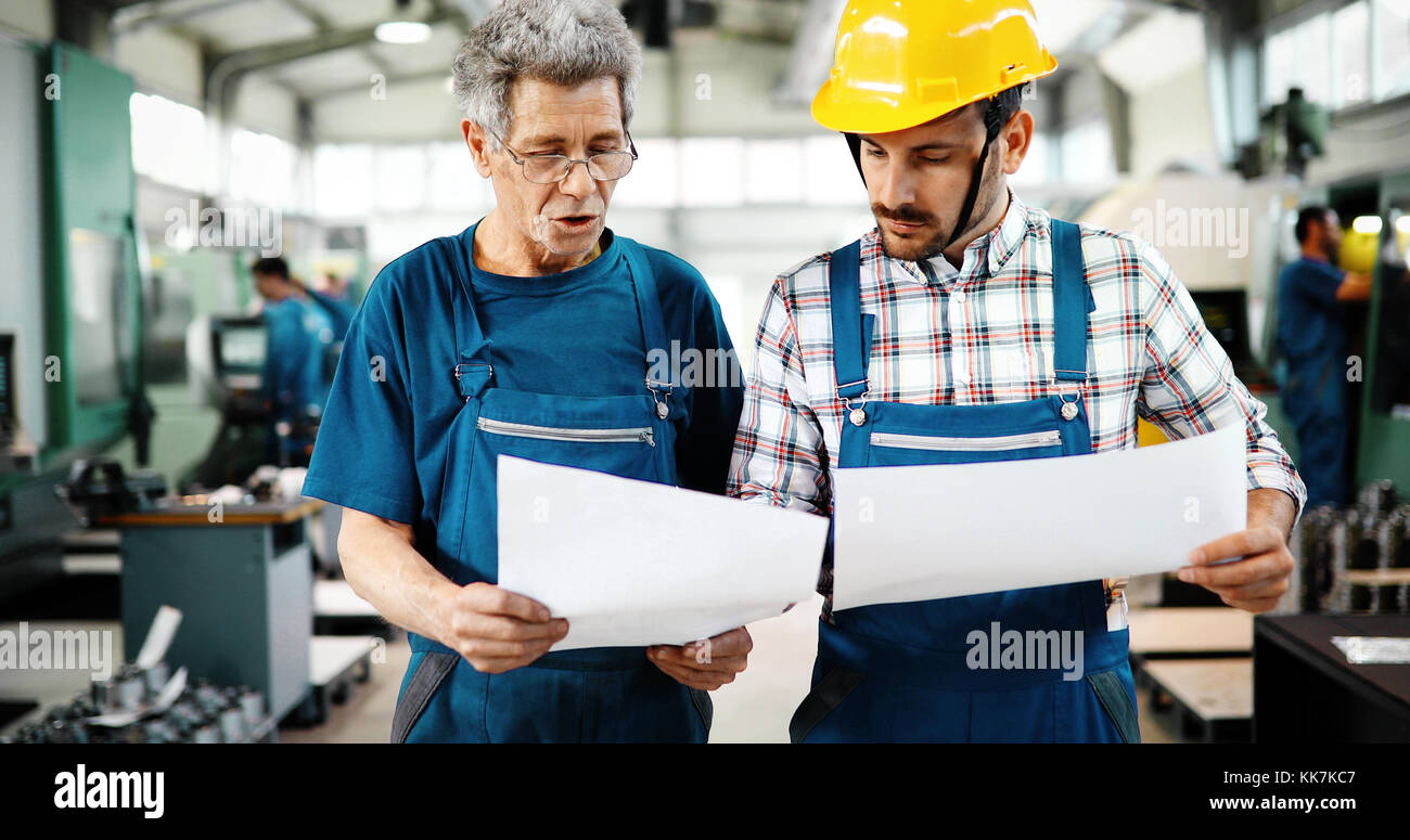 Team Of Engineers Having Discussion In Factory - Stock Image