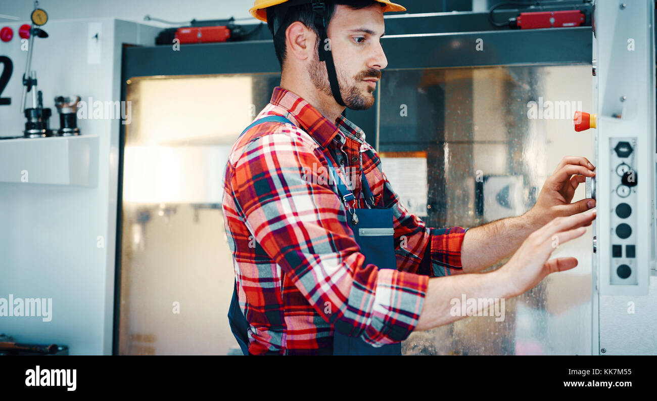 Portrait of an handsome engineer in a factory - Stock Image