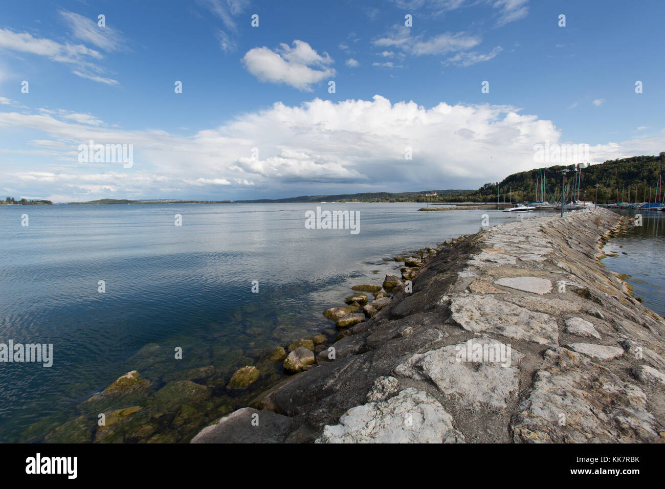 Town of Le Landeron, Switzerland. Picturesque view of Lake Biel with Le Landeron marina breakwater in the foreground. - Stock Image