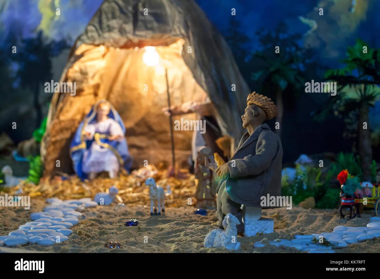 brazilian christmas manger scene with figurines including jesus mary joseph sheep and magi