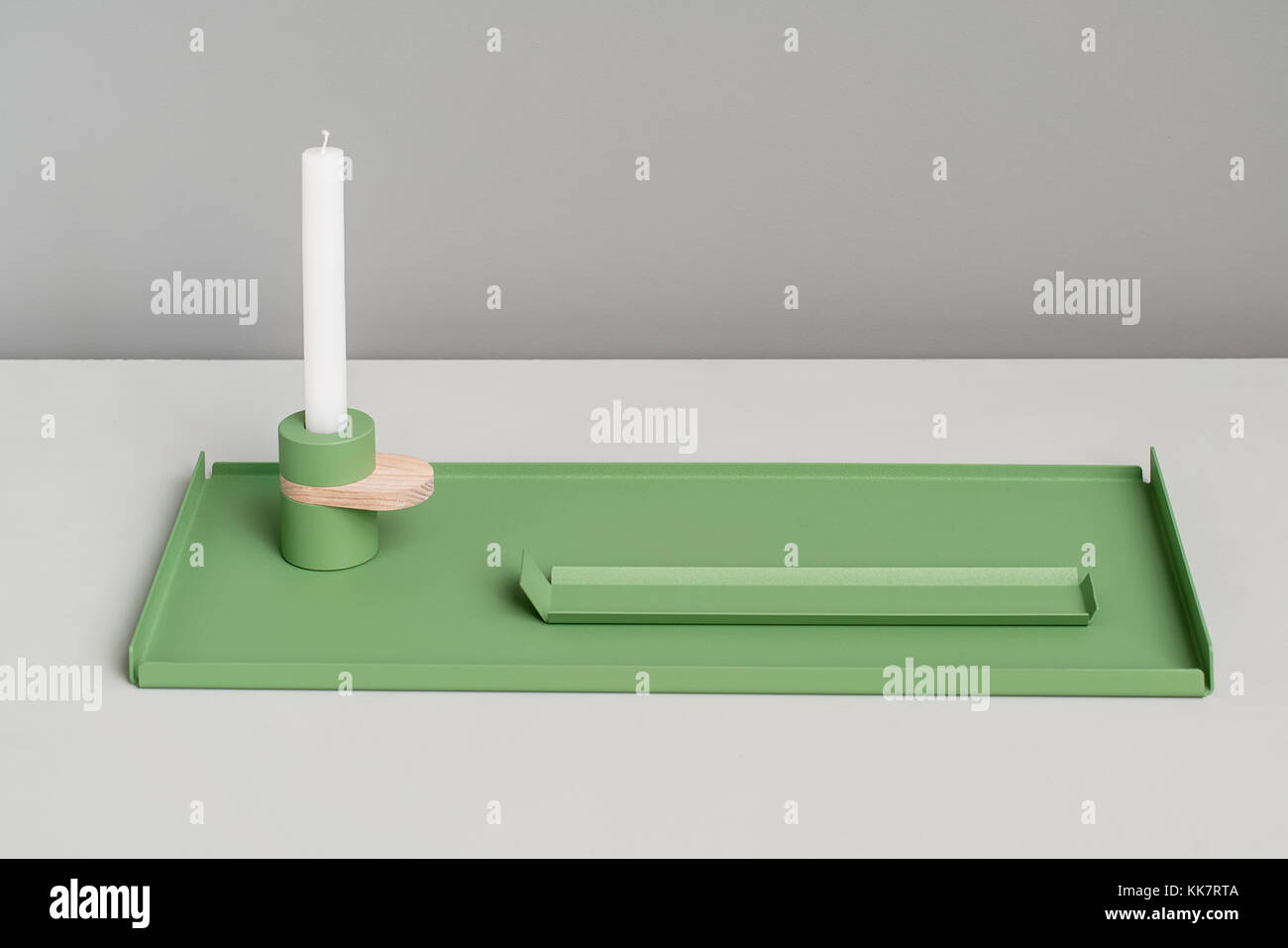 Metal green supports and candlestick - Stock Image