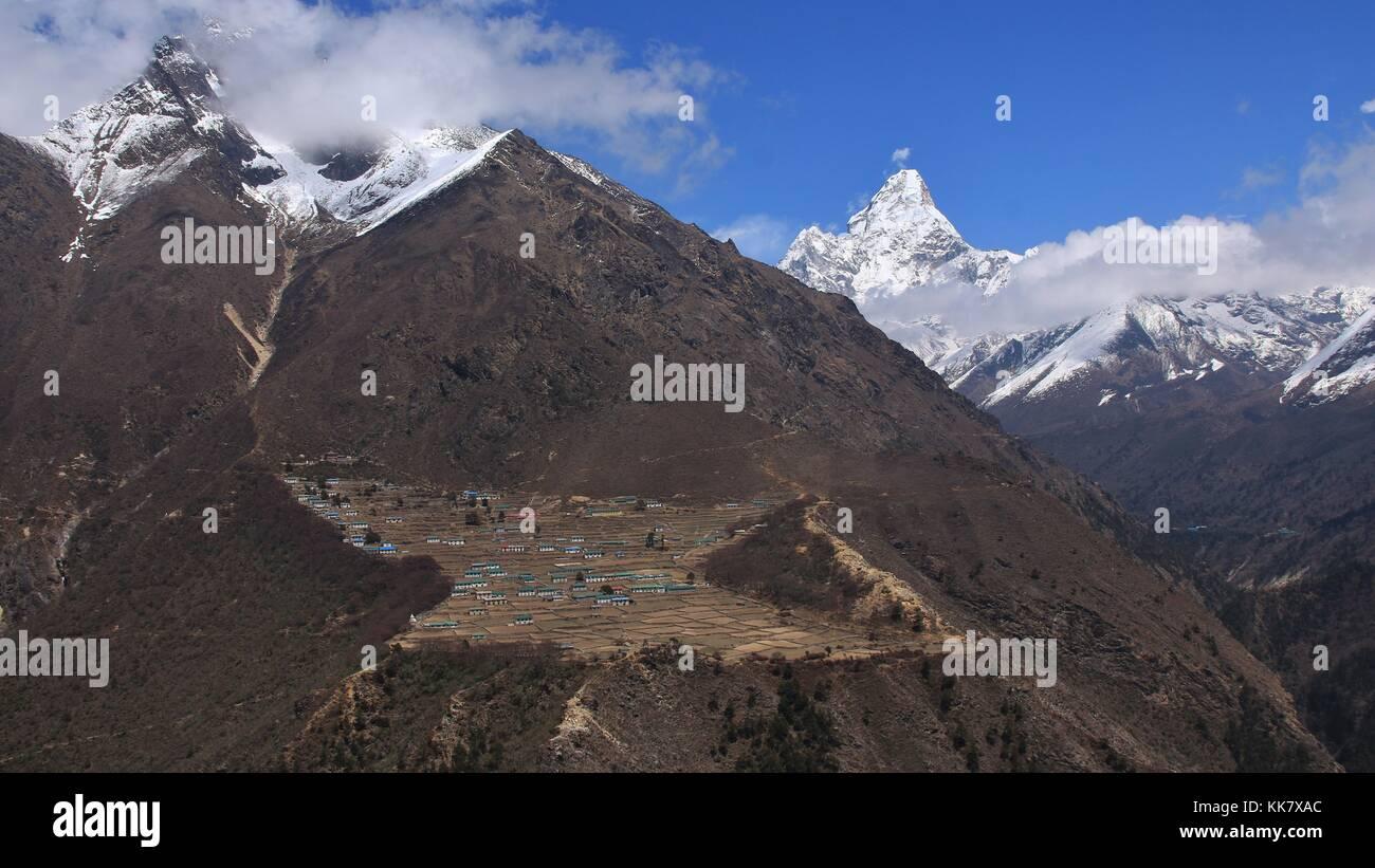 Spring scene in the Sagarmatha National Park, Nepal. Village Phortse and famous mountain Ama Dablam. - Stock Image