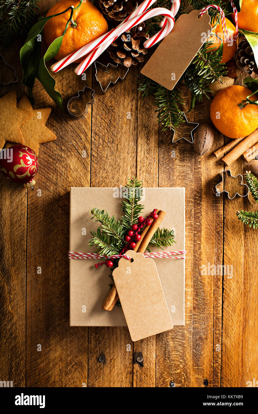 Christmas present with oranges, candy canes and decorations - Stock Image