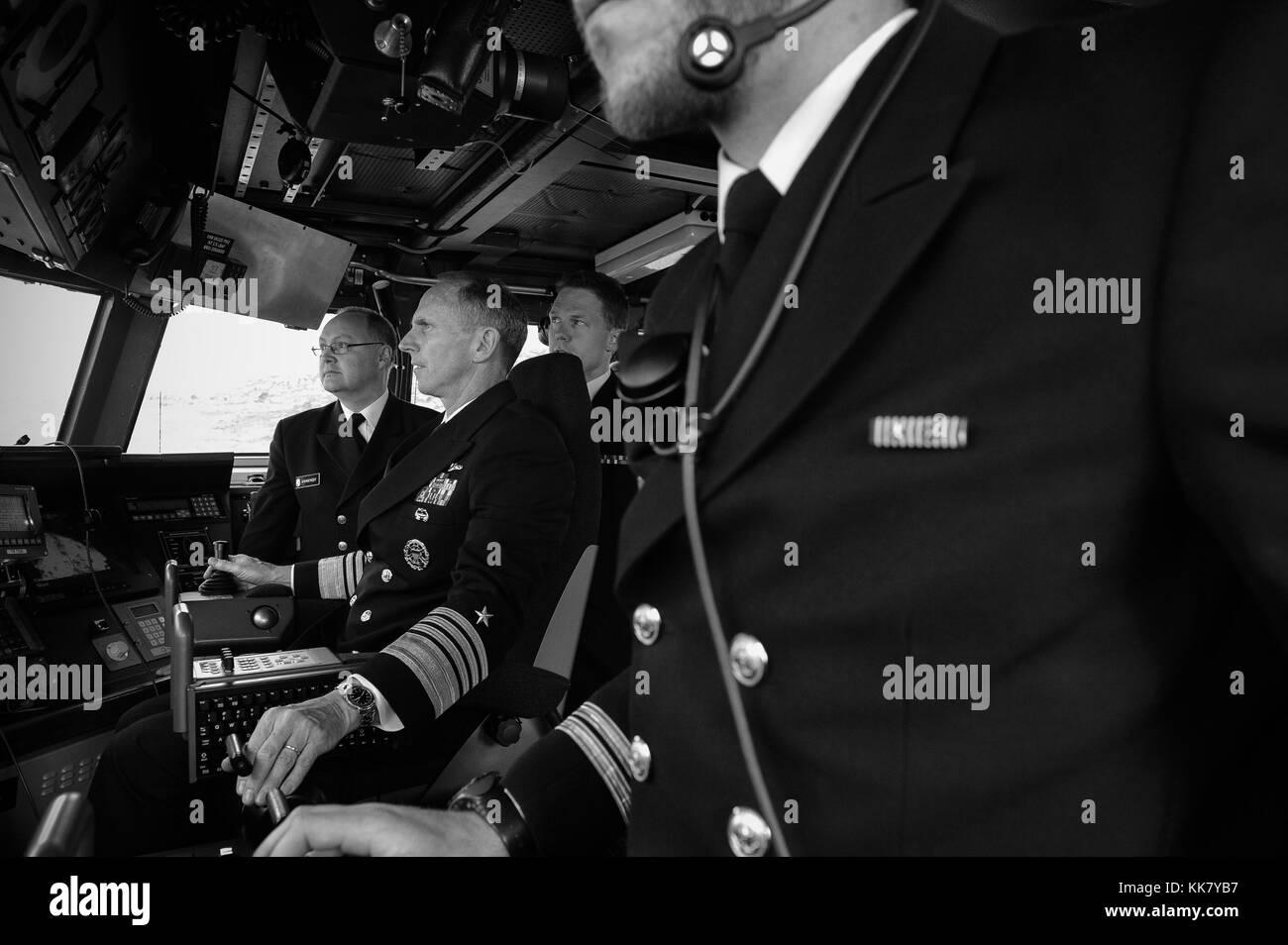 Chief of Naval Operations CNO Admiral Jonathan Greenert pilots the Skjold-class coastal corvette HNoMS Skudd P962 - Stock Image