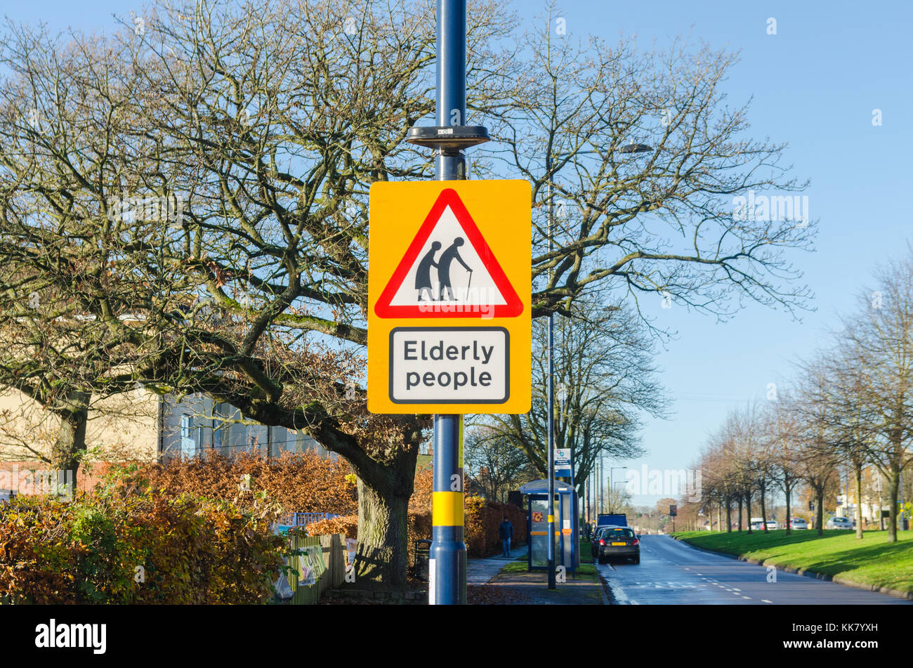 Sign warning of elderly people crossing the road - Stock Image
