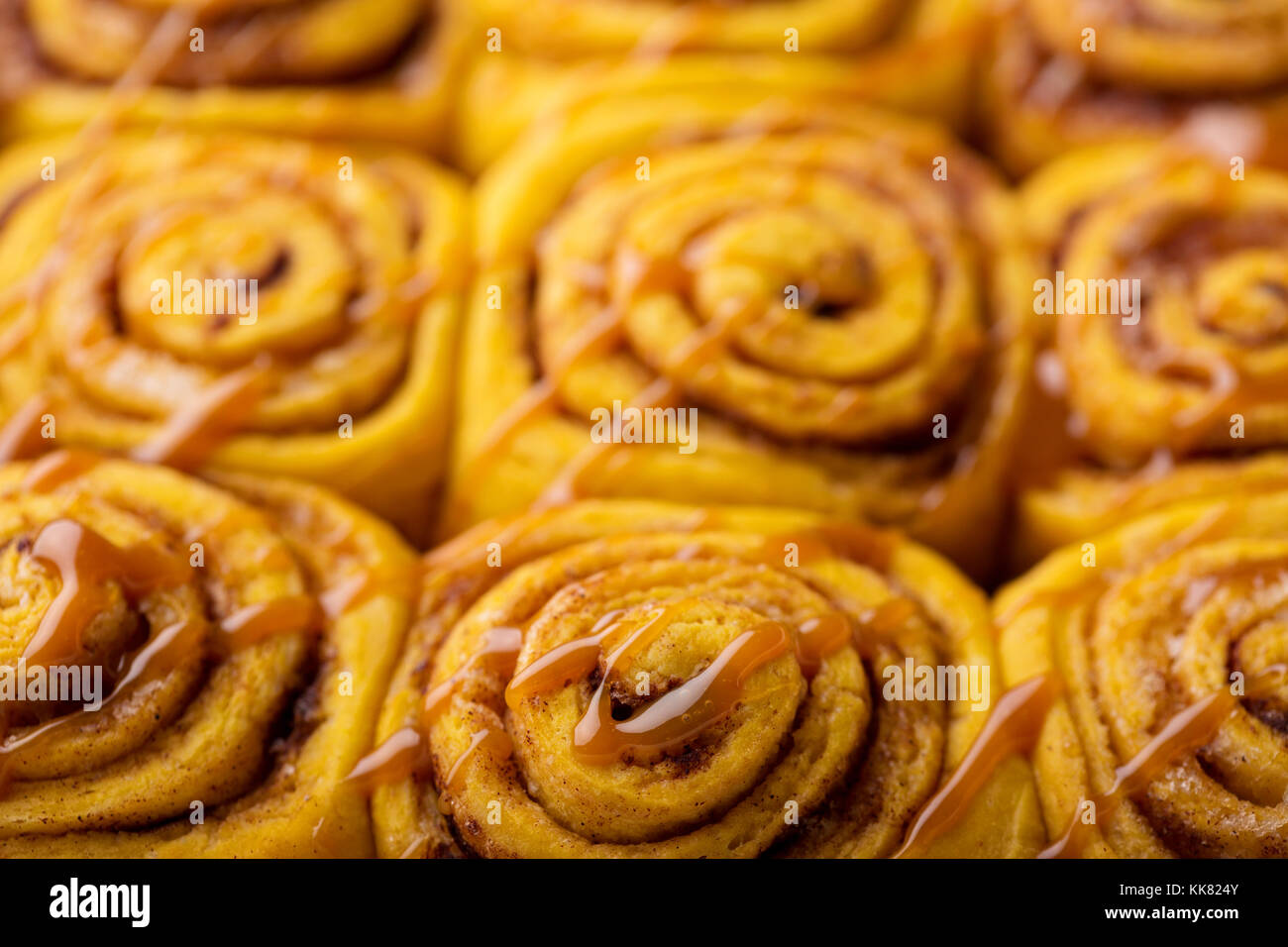 Pumpkin cinnamon rolls close up - Stock Image