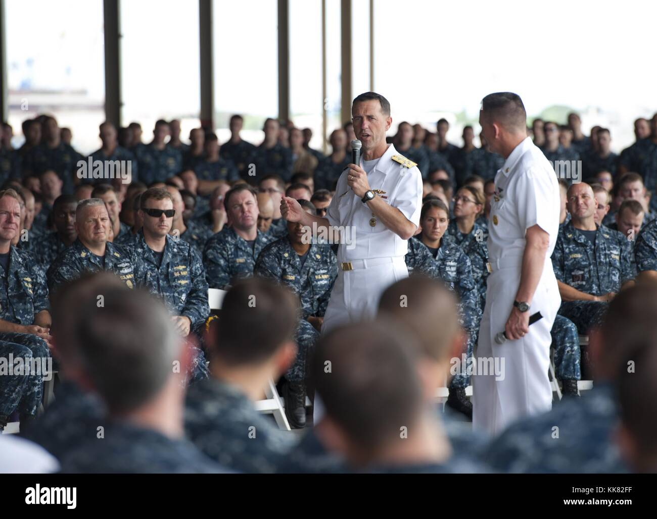 Chief of Naval Operations CNO Admiral John Richardson answers a Sailor's question during an all-hands call at - Stock Image