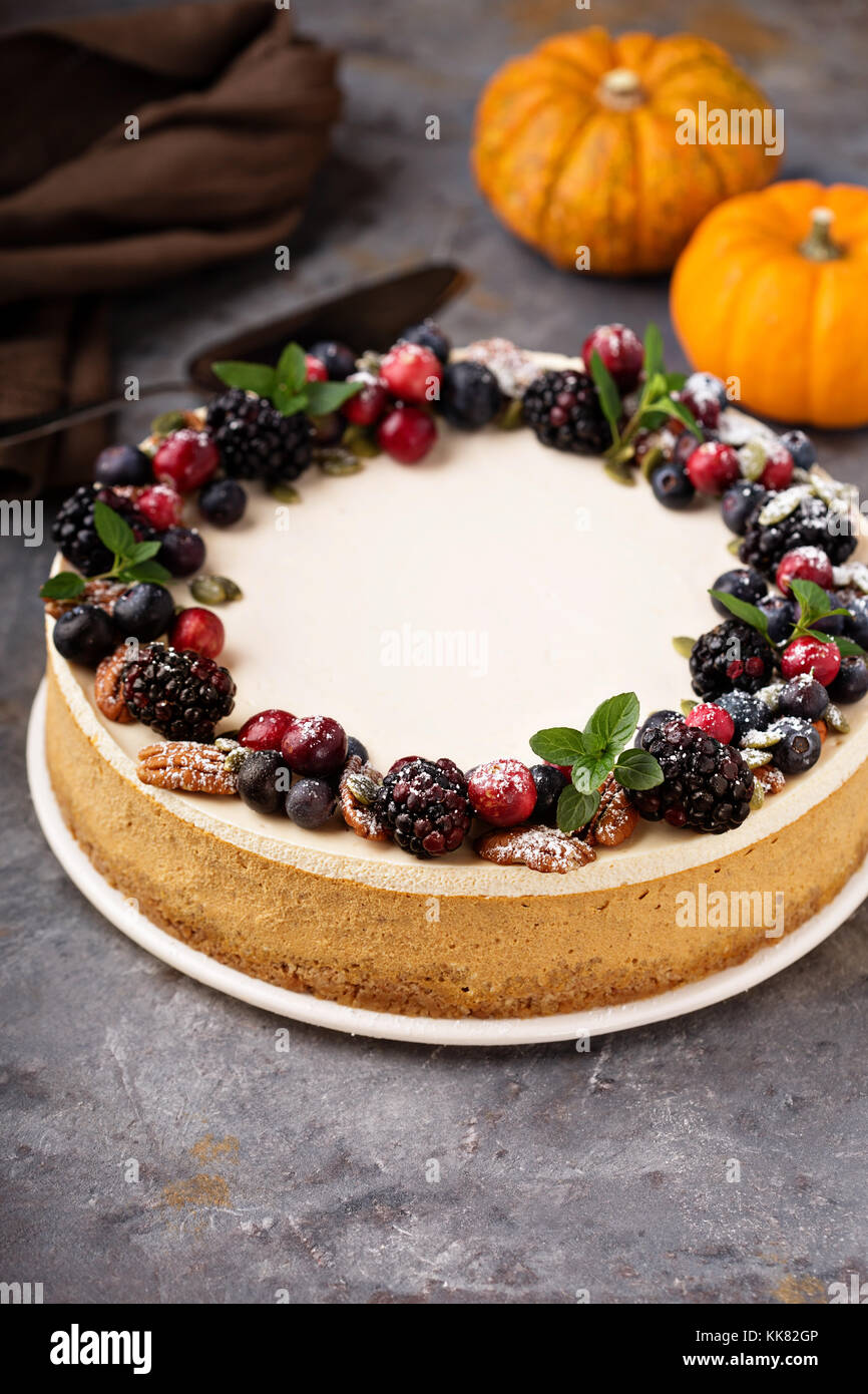 Pumpkin cheesecake with sour cream topping - Stock Image